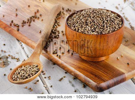 Hemp Seeds On A Wooden Board.