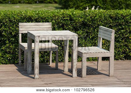 White Wooden Table And Chairs Outdoors