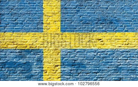 Sweden - National flag on Brick wall