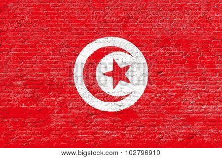 Tunisia - National flag on Brick wall