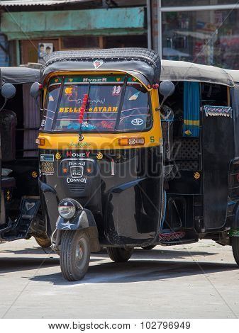 Auto Rickshaw Taxi On A Road In Srinagar, Kashmir, India.
