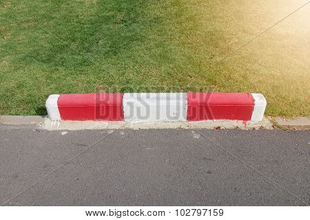 Painting On Footpath And The Street With Red And White Color In Public Park