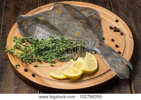 Flounder With Pepper, Thyme And Lemon On The Board