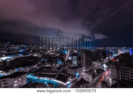 Cool Photo Of Quito At Night Showing Parts Of The City With Lit Up Buildings Skyline In A Dark Blue
