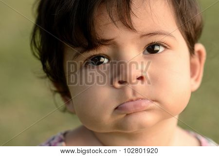 cute adorable beautiful face of mixed race baby with innocent expression