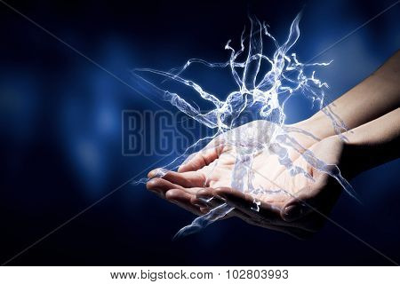 Close up of man hand holding nerve symbol