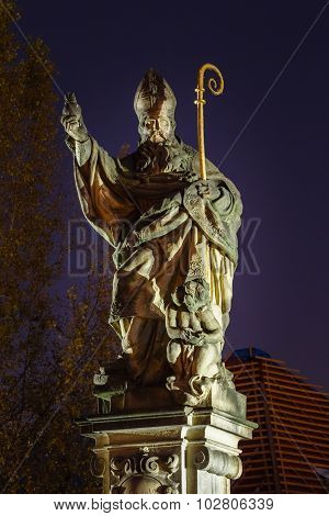 Statue of St. Augustine on Charles bridge, Prague, Czech republi