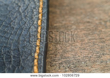 Old Skin With A Seam On A Wooden Surface Macro