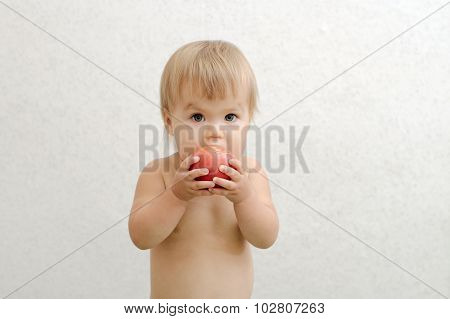Child Bitting Tomato