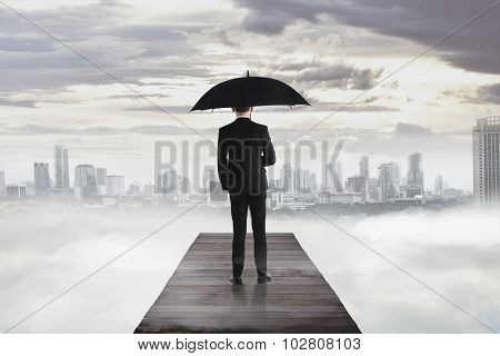 Business Man Standing On The Wooden Pier