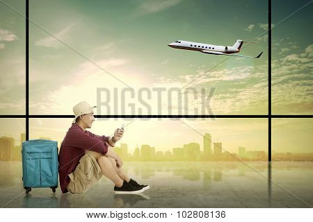 Asian Tourist Waiting
