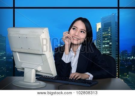 Business Woman Working Late