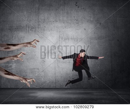 Business Man Running With Zombie