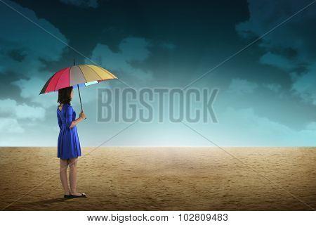 Business Person Hold Umbrella On Desert
