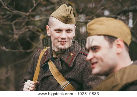 Two unidentified re-enactors dressed as Soviet soldiers