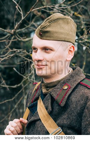Unidentified re-enactor dressed as Soviet soldier in overcoat.