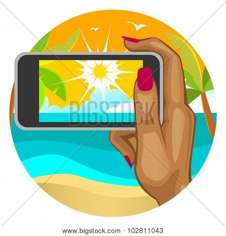 Woman's Hand With The Smart Phone In The Background Of The Beach.