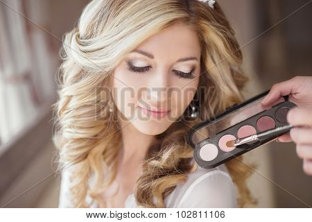 Beautiful Bride Wedding With Makeup And Curly Hairstyle. Stylist Makes Make-up Bride On Wedding Day.