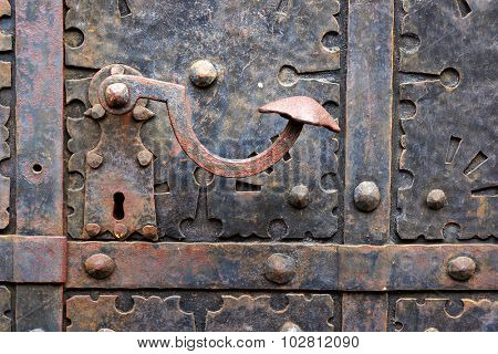 Ancient iron door handle on iron medieval door in Gdansk, Poland.