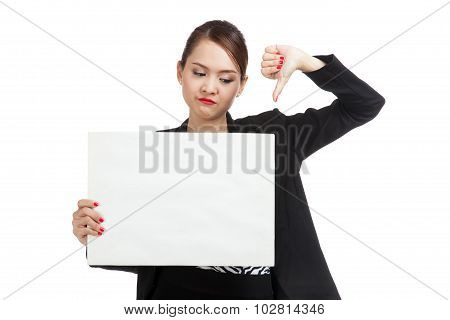 Young Asian Business Woman Show Thumbs Down With  White Blank Sign