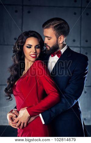 Young elegant embracing couple portrait.