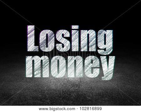 Currency concept: Losing Money in grunge dark room