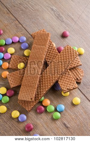 Long Chocolate Biscuits On Heap With Sweets