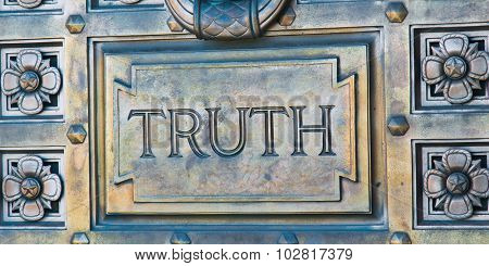 Word Engraved on Bronze Door with Truth