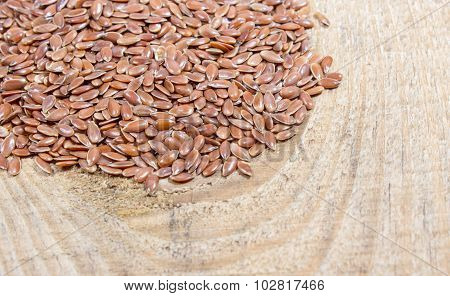 Flaxseed On Wood Background
