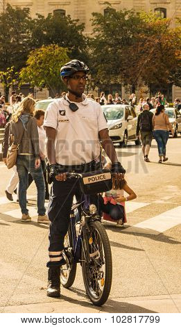 The policeman on bicycle patrol.