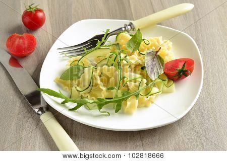 Italian pasta noodles with zucchini arugula basil