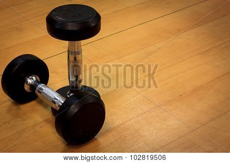 Dumbbells On The Wood Background And Vignetting.