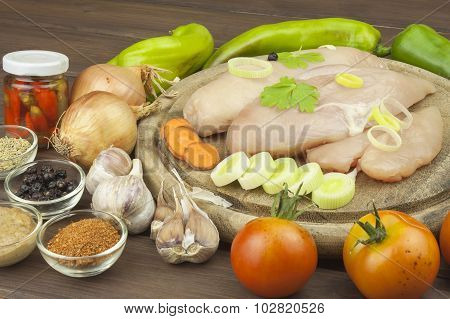 Preparing Diet food. Fresh raw chicken fillet and vegetables prepared for cooking.