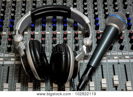 Microphone And Headphone On The Sound Mixer Background.