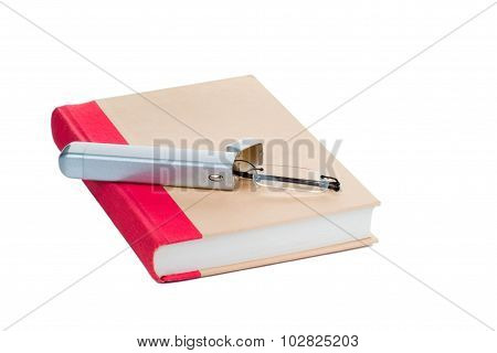 Eye glasses on a book, isolated on white background