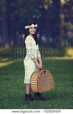 vintage young girl with picnic basket