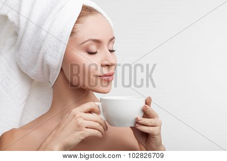 Cheerful young woman is resting after shower
