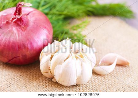 Red Onions, Dill And Garlic On  Table