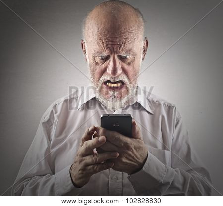Angry man trying to use a smartphone