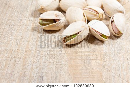 Pistachios On Wood Background.