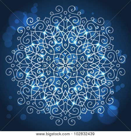 Abstract Blue Background With A Round Mandala Ornament, Sparkles And Bokeh