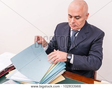 Business Man With Your Files And Paperwork On Desk, In Office.