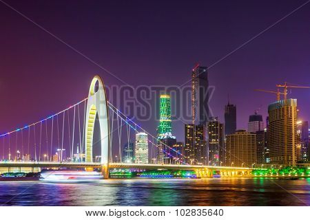cable stayed bridge over a river at night