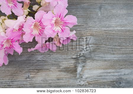 greeting card with vintage flowers on blurred wooden background