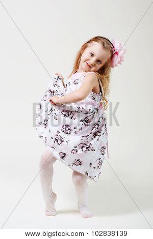 Full Length Portrait Of A Cute Little Blonde Girl Dancing