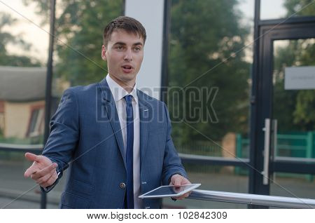 Businessman Talk With Laptop In Left Hand