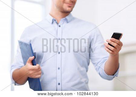 Professional realtor holding folder