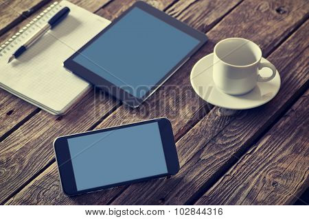 Smartphone and digital tablet devices on a desktop. Clipping paths included.