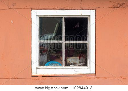 Rustic vintage window on red wall