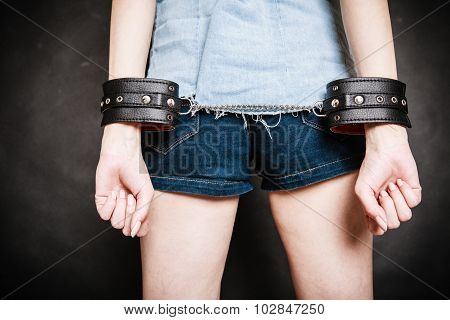 Arrest. Leather Handcuffs On Hands Prisoner Girl